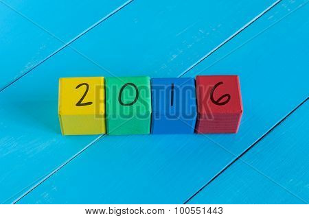 Happy new 2016 year. Colorful design.  Numeral on children's colourful cubes or blocks