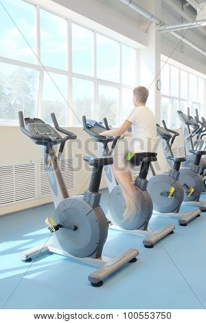 men is engaged on a stationary bike