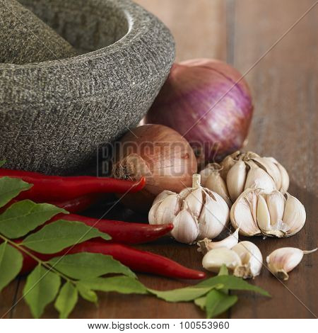 mortar and the spices on the wooden background
