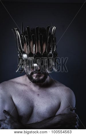Chef, naked man with a crown of forks  in the head, concept designer kitchen