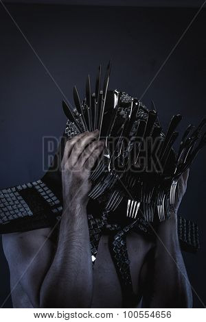 naked man with a crown of forks and knives in the head, concept designer kitchen