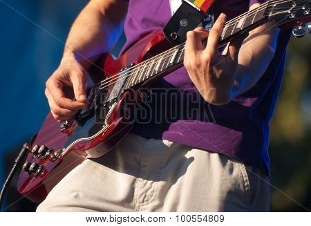 Hands Of Guitarist In Concert