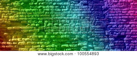 Concept or conceptual colorful painted or graffiti old vintage grungy brick wall texture or urban background banner