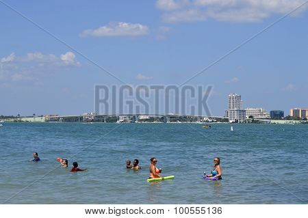 Sand Key in Florida, USA - May 10, 2015 tourists in the sea enjoying the sun