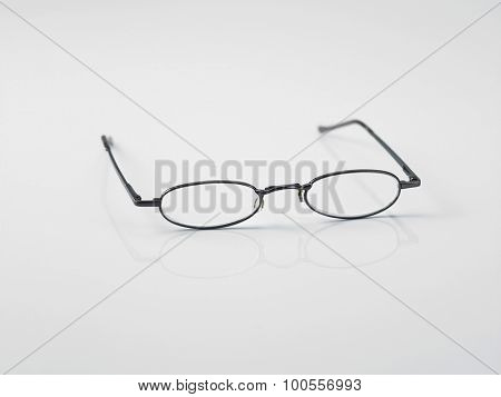 Close up shot of reading glasses on a white background