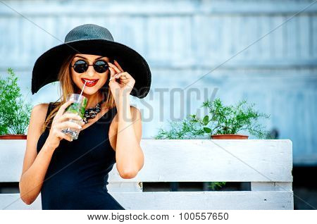 Pretty Young Girl Drink Cold Coctail Outdoor In Beach Cafe
