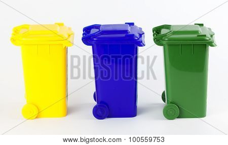 Colorful recycle bins isolated on white