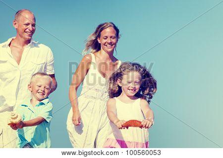 Family Bonding Running Sand Beach Summer Concept