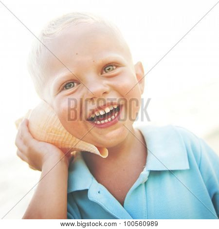 Little Boy Having Fun On A Beach Laughing Concept