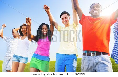 Multi-Ethnic Teenagers Outdoors Holding Hands Concept