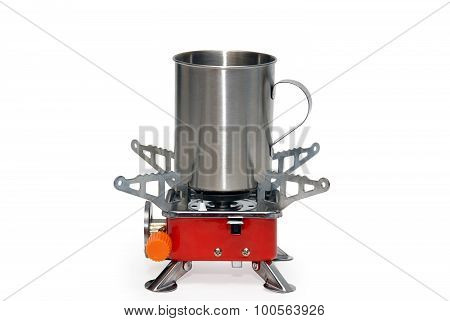 Portable gas torch with metal mug. Isolated on a white