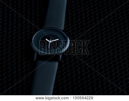 Luxury mens watch made of black high-tech ceramics. Close-up studio photo with selective focus