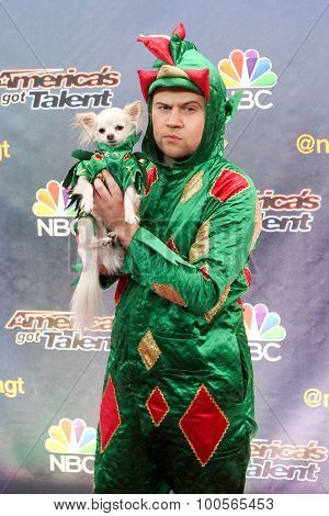 NEW YORK-AUG 11: Comedian Piff the Magic Dragon and his dog Mr Piffles attend the 'America's Got Talent' season 10 taping at Radio City Music Hall on August 11, 2015 in New York City.