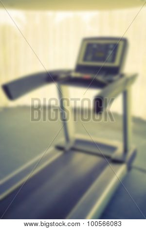 Abstract blur Fitness center with traineger equipments  ( Filtered image processed vintage effect. )