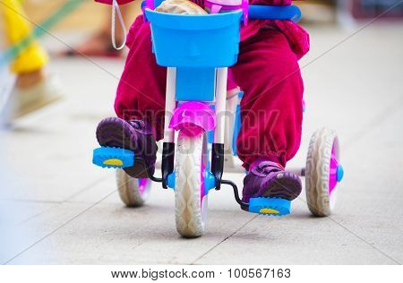 Baby On A Tiny Bike
