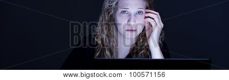 Woman Sitting At The Computer
