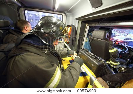 MOSCOW - December 8, 2014: firemen ride a call in a service car