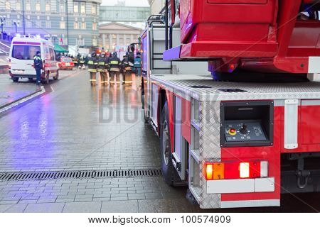 MOSCOW - December 8, 2014: control panel of a fire truck ladder and Firemen