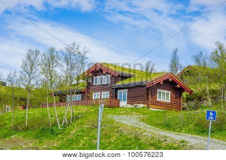 VALDRES, NORWAY - 6 JULY, 2015: Traditional norwegian mountain cabins of wood with grassy rooftops l