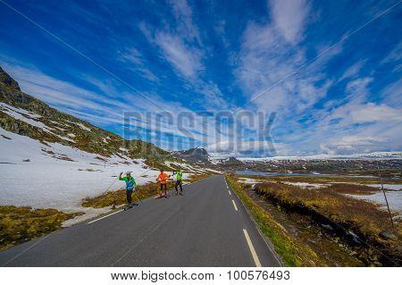 VALDRES, NORWAY - 6 JULY, 2015: Beautiful road passing through Valdresflya mountain range sorrounded