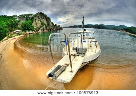 Fish-eye view of boat in the Russian Primorye Spokoynaya bay HDR image