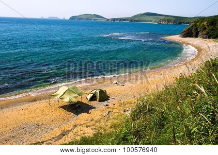 lone camping on desert beach on the russian isle Putyatin