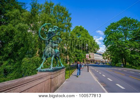 OSLO, NORWAY - 8 JULY, 2015: Famous Ankerbrua with its recognizable animal statues located in the he