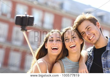 Group Of Tourist Friends Taking Selfie With Smart Phone