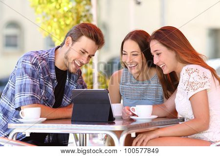 Three Friends Watching Tv Or Social Media In A Tablet