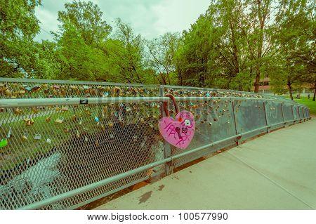 OSLO, NORWAY - 8 JULY, 2015: Alongside Akerselva river passing through city, bridge with many locks