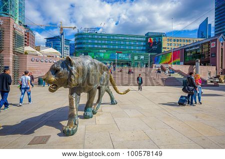 OSLO, NORWAY - 8 JULY, 2015: Plaza in front of Oslo Central station with people around and cool tige