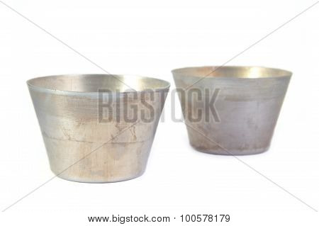 Two circular metal baking moulds for cooking ring cake, flan or creme caramel