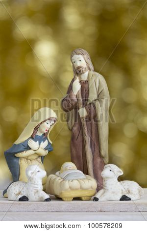 Nativity Scene on Golden Background with Copy Space