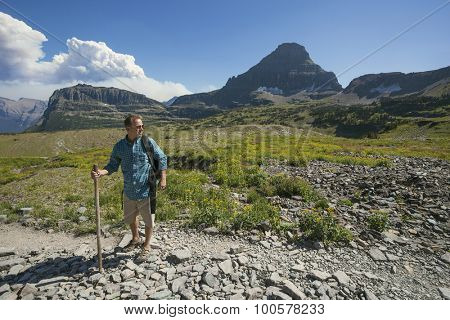 Man hiking in in the beautiful mountains of Glacier National Park