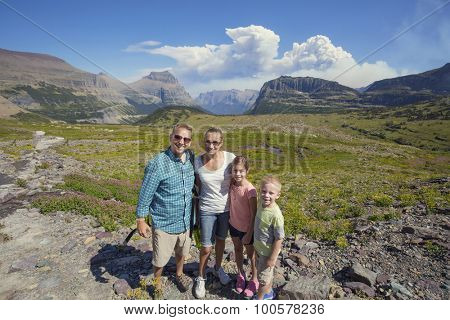 Family hiking in in the beautiful mountains of Glacier National Park