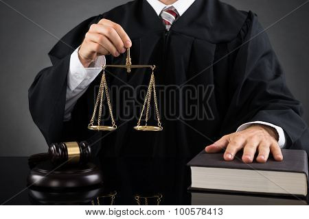 Judge Holding Weight Scale