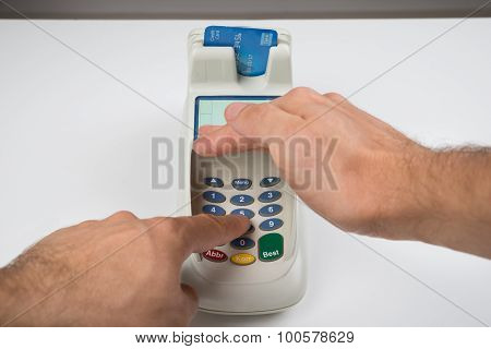 Person Hand Entering Code In A Card Reader