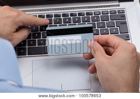 Person With Credit Card Shopping Online