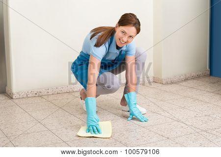 Janitor Cleaning Floor With Rag