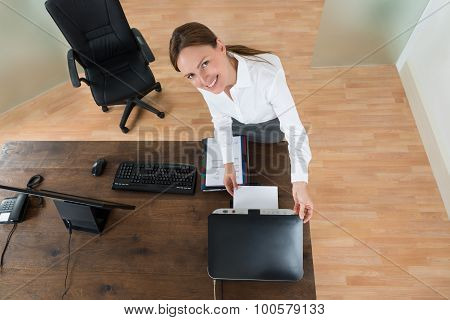 Young Businesswoman Using Printer In Office