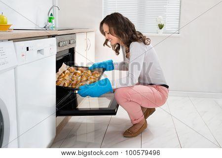 Woman Baking Bread Roll