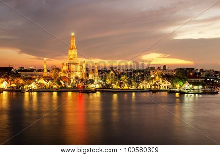 Night View Of Wat Arun Temple And Chao Phraya River, Bangkok, Thailand