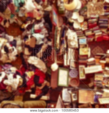 defocused blur background of an aerial view of a stall in a flea market full of bits and pieces