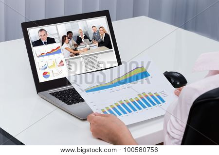 Businessperson Videoconferencing On Laptop