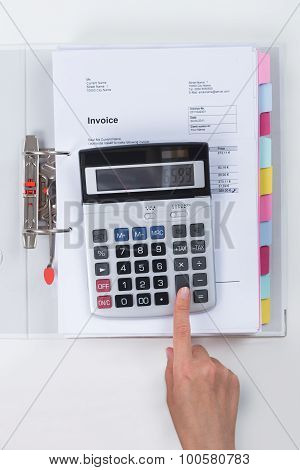 Businessperson Calculating Tax With Calculator