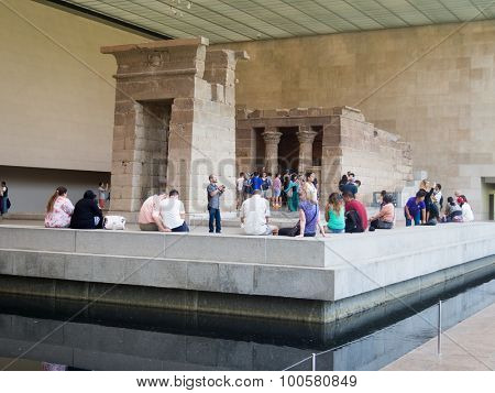 NEW YORK,USA- AUGUST 18,2015 : Visitors at the egyptian Temple of Dendur on the Metropolitan Museum of Art