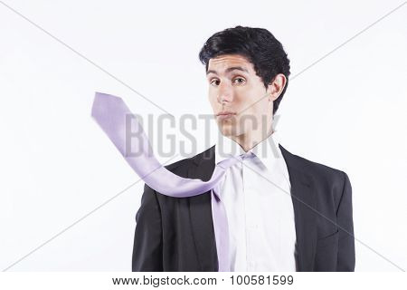 Businessman surprised with his flying necktie (isolated on gray)