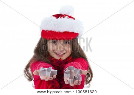 Little girl with a santa claus hat showing baking forms