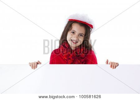 Little girl with a santa claus hat