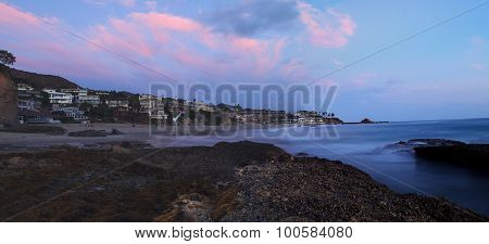 Panoramic of Victoria beach homes at sunset in summer.